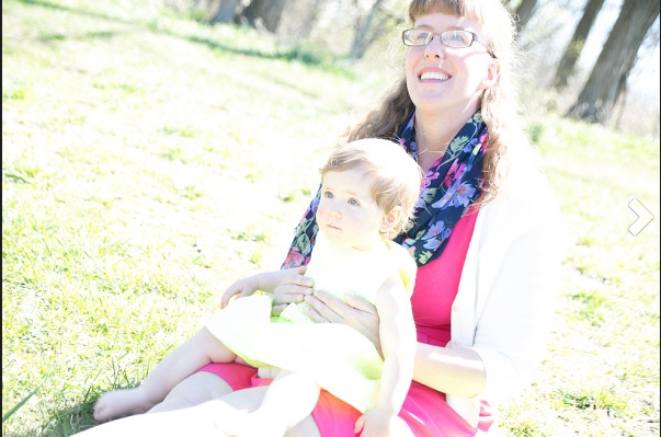 Jenny Corbett, DC doula, in the sun with her young daughter.