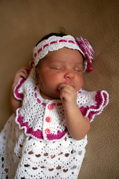 Sweet Silver Spring Doula African American Baby girl in crocheted outfit